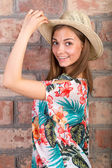 The beautiful girl in a summer hat. Studio portrait — Stock Photo