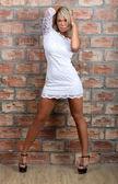 Charming girl white mini dress. — Stock Photo