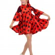 Girl dancing in a red polka-dot dress — Stock Photo #29382361