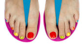Beautiful female feet with a pedicure color — Stock Photo