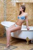 Beautiful girl in blue underwear in the bathroom — Stock Photo