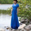 Stock Photo: Girl in blue evening dress