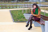 Girl sitting on the bench — Stock Photo