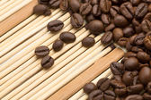 Coffee beans on a bamboo napkin — Stock Photo