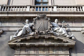 Two maidens on the facade of an old building — Stock Photo