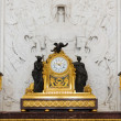 Antique clock in gold case in the interior Hermitage Museum — Stock Photo
