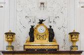 Antique clock in gold case in the interior Hermitage Museum — Stock Photo