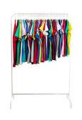 Multicolored clothes on hangers, isolate — Stock Photo