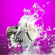 Auto parts, engine cooling pump in spurts of water on purple bac — Stock Photo #49901787