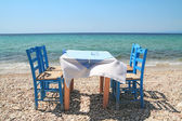 Greek tavern by the sea — Stock Photo