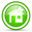 Home green glossy icon on white background - Stock Photo