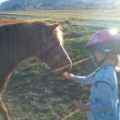 Stock Photo: Animals & Wildlife. Girl and horse