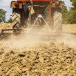 Tractor harrowing the land — Stock Photo
