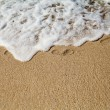 Footprint on sand with foam  — Stock Photo
