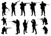 Siluetas de los cazadores — Vector de stock