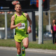 An unidentified man runs in 26th Belgrade Marathon on April 21, 2013 in Belgrade, Serbia — ストック写真
