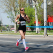 An unidentified woman runs in 26th Belgrade Marathon on April 21, 2013 in Belgrade, Serbia — Stok fotoğraf
