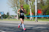 An unidentified woman runs in 26th Belgrade Marathon on April 21, 2013 in Belgrade, Serbia — ストック写真