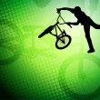 Bmx cyclist  on the abstract background - vector — Stockvectorbeeld