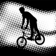 Bmx cyclist  on the abstract background — Imagens vectoriais em stock