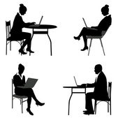 Business people working on their laptops silhouettes — Stock Vector