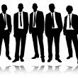 Group of businessmen standing and posing — Vettoriali Stock