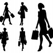 Stock Vector: Women with shopping bags silhouettes