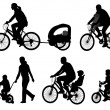 Parents riding bicycles with their kids silhouettes — Stock Vector
