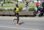 Undefined man runs on   April 27, 2014 in 27th Belgrade marathon — Stock Photo