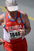 Undefined man runs on   April 27, 2014 in 27th Belgrade marathon — Stock Photo