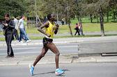 An unidentified woman   runs in 26th Belgrade Marathon on April 27, 2014 in   Belgrade, Serbia — Stock Photo
