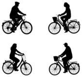 City bicyclists silhouettes — Stock Vector