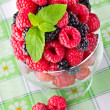 Sweet fresh fruits in glass goblet with mint leaf - Foto de Stock