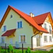 Stock Photo: New build house at sunny sky day
