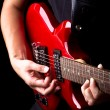 Closeup view of playing electric red guitar — Stock Photo