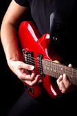 Closeup view of playing electric red guitar — Stok fotoğraf