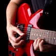 Stock Photo: Closeup view of playing electric red guitar