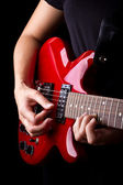 Closeup view of playing electric red guitar — Foto de Stock