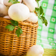 Wicker basket full of fresh champignon mushrooms — Stock Photo