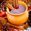 Stock Photo: Mulled wine in brown jug with cinnamon and anise
