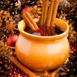 Mulled wine in brown jug with cinnamon and anise — Stock Photo