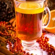 Mulled wine with cinnamon sticks and christmas anise stars — Stock Photo