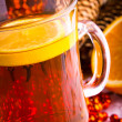 Mulled wine with cinnamon sticks and christmas anise stars — Stock Photo #16205511