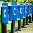 Royalty-Free Stock Photo: Blue public phone in a row