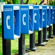 Stock Photo: Blue public phone in row