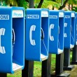 Blue public phone in a row — Stock Photo #17355563