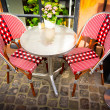 Vintage old fashioned cafe chairs with table in Copenhagen — Stock Photo #17859543
