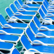 Close up view of blue deck chairs — Stock Photo