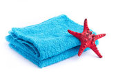 Blue towel with red starfish isolated on white background — Stock Photo