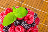Sweet fresh fruits with mint leaf — Stock Photo